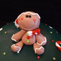 Cute Gingerbread cake topper. Sugar paste modeling, chocolate cake inside