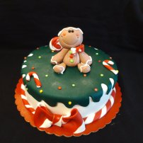 Sugar paste modeling, Christmas cake, cute gingerbread man.